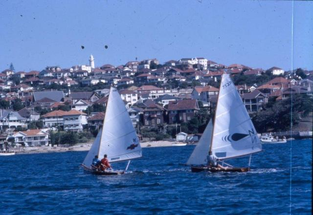 CRSC VJs at Vaucluse Jan 1965, Rob Lowndes sailing Peta at left leads Australian Junior champion 'Daze'