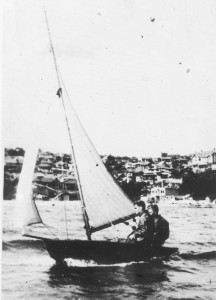 Charles Sparrow at the helm with brother Tom crewing, sailing the very first VJ 'Chum' on Sydney Harbour at Vaucluse 1932